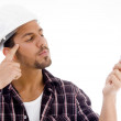 Innovative male looking at electric bulb — Stock Photo