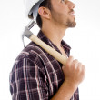 Side pose of architect holding hammer — Stock Photo #1666704