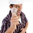 Engineer showing electric bulb — Foto de Stock
