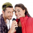 Young male and female singer with mic — Stock Photo
