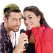 Young male and female singer with mic — Stok fotoğraf