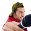 Male singer showing microphone — Stock Photo
