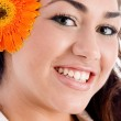 Close up of pretty model with flower — Stock Photo