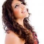 Beautiful woman looking upwards — Stock Photo #1667053