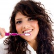 Young pretty female holding toothbrush — Stock Photo