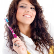 Young pretty female holding toothbrush — Stock Photo #1667151