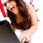 Christmas lady working on laptop — Stock Photo