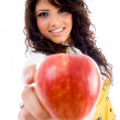 Beautiful young woman holding red apple — Stock Photo