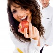 Gorgeous woman and handsome male chef — Stock Photo