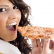 Pretty woman eating delicious pizza — ストック写真