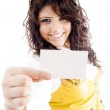 Female holding business card at camera — Stock Photo