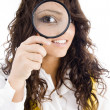 Young girl holding magnifier — Stock Photo #1667293