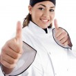 Successful female chef showing thumbs up — Stock Photo #1667354