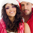 Stock Photo: Young amorous couple smiling at camera