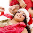Christmas couple lying on floor — Stock Photo