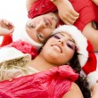 Christmas couple lying on floor — Stock Photo #1667430