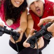 Young loving couple playing video games — Stok fotoğraf