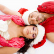 Stock Photo: Loving american couple lying on floor