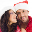 Cheerful young couple in christmas hat — Stock Photo
