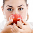 Young attractive woman holding an apple — Stock Photo