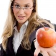 Stock Photo: Young woman showing an apple