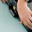 Royalty-Free Stock Photo: Hands holding office suitcase