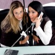 Female executives busy on phone call — Stock Photo