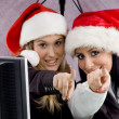 Stock Photo: Colleagues wearing christmas hat