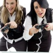 Beautiful sisters playing video games — Stock Photo #1668492