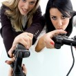 Female partners playing videogame — Stock Photo