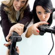 Stock Photo: Female partners playing videogame