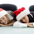 Young colleagues wearing christmas hat - Stock Photo