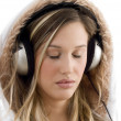 Beautiful female tuned into music — Stock Photo