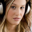 Beautiful young woman enjoying music — Stock Photo