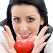 Caucasian model holding small red heart — Stock Photo #1669187