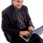 Businessman working on laptop — Stock Photo #1669776