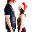 Chrisatmas couple looking at each other — Stock Photo #1669790