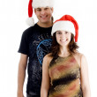 Young couple wearing christmas hat — Stock Photo