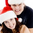 Young couple with christmas hat — Stock Photo
