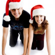 Stock Photo: Couple with christmas hat smiling