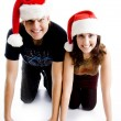 Couple with christmas hat smiling — Stock Photo