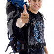 Traveler with rucksack and thumbs up - Stock Photo