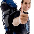 Traveler with bag showing thumbs up — Stock fotografie