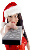 Beautiful young woman holding tv remote — Stock Photo