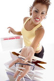 Smiling female with holding carry bags — Stock Photo
