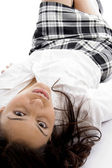 Young girl lying and looking at camera — Stock Photo