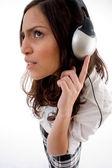 Pretty caucasian enjoying music — Stock Photo