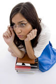 Pretty female with school bag and books — Stock Photo
