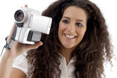 Photographer making video with handy cam — Stock Photo