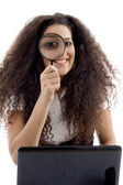 Latin american female holding magnifier — Stock Photo